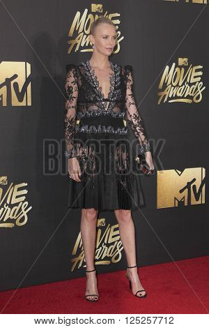 LOS ANGELES - APR 9:  Charlize Theron at the 2016 MTV Movie Awards Arrivals at the Warner Brothers Studio on April 9, 2016 in Burbank, CA