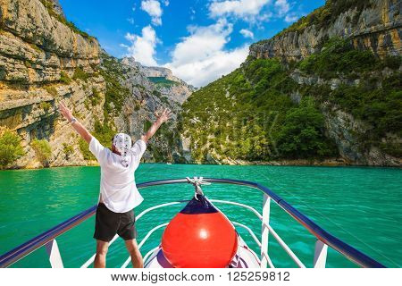 Travel on the river Verdon. The enthusiastic tourist on  boat with red lantern