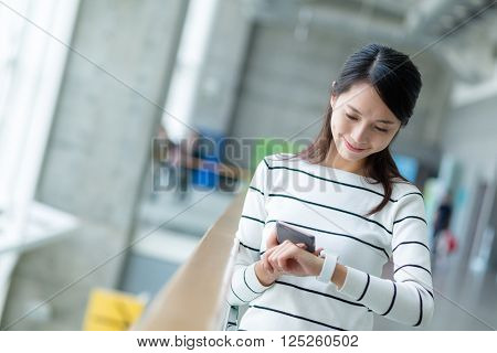 Woman connect the smart watch and cellphone