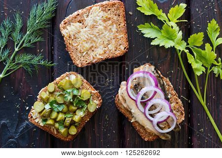 Sandwich With Garlic, With Sprats And Pickled Gherkins With Parsley