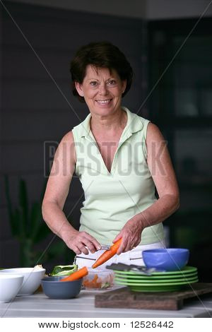 Portrait of senior housewife cooking