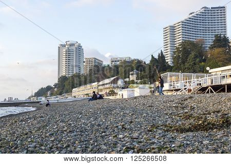 SOCHI, RUSSIA - November 06, 2016: The sea stone beach against multi-storey buildings and hotels. Sochi, Russia