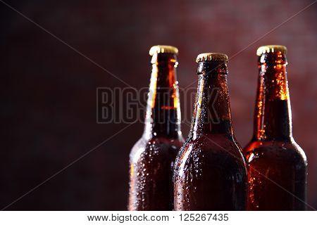 Brown glass bottles of beer on blurred background