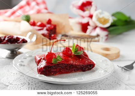 Cherry strudel with mint on plate