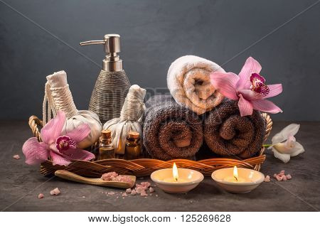 Beautiful SPA composition Towels sea salt essential oil and a burning candles