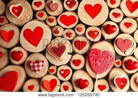 Valentine's Day concept. Different colourful hearts on wooden stumps background