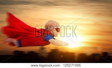 toddler little baby superman superhero with a red cape flying through sunset sky above the city