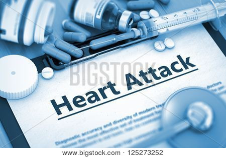 Heart Attack Diagnosis, Medical Concept. Composition of Medicaments. Heart Attack - Printed Diagnosis with Blurred Text. Heart Attack, Medical Concept with Pills, Injections and Syringe. 3D Toned Image.