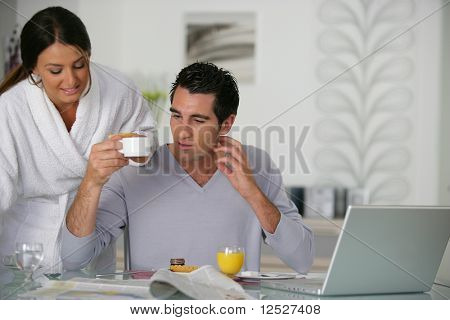 Portrait of a man and a woman having breakfast