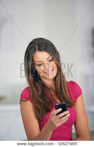 Portrait of a smiling woman with a cell phone