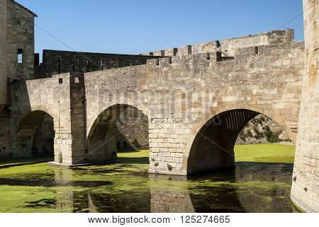 Aigues-Mortes (Gard Languedoc-Roussillon France): historic bridge and moat