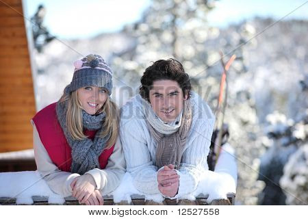 Portrait of a smiling couple at the snow