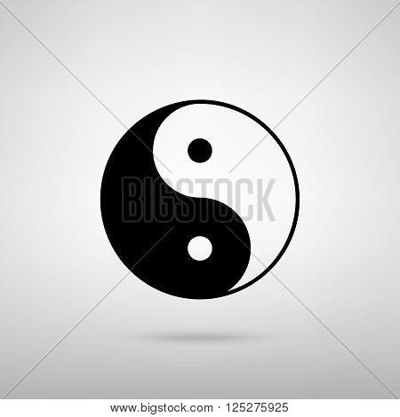 Ying yang symbol of harmony and balance. Black with shadow on gray.