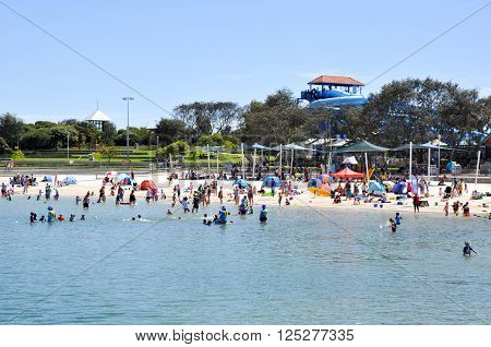 HILLARYS,WA,AUSTRALIA-JANUARY 22,2016: Families relaxing on the beach with water recreation at Hillarys Boat Harbour, in Hillarys, Western Australia.