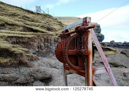 Old rusted machinery at the coastline in the Faroe Islands