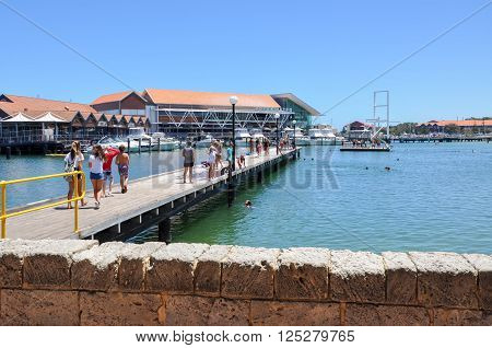 HILLARYS,WA,AUSTRALIA-JANUARY 22,2016: Jetty and swimming cove with tourists at Hillarys Boat Harbour in Hillarys, Western Australia.