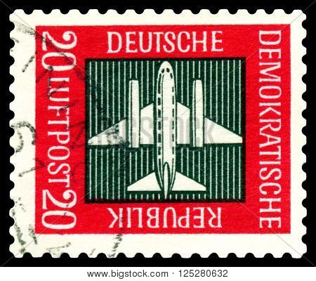 STAVROPOL RUSSIA - APRIL 05 2016: a stamp printed by GDR shows Stilized plane payment airmail circa 1957
