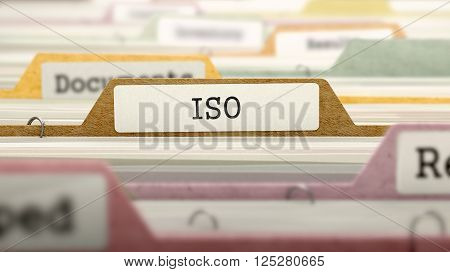 ISO - International Organization Standardization - Folder Register Name in Directory. Colored, Blurred Image. Closeup View. 3D Render.