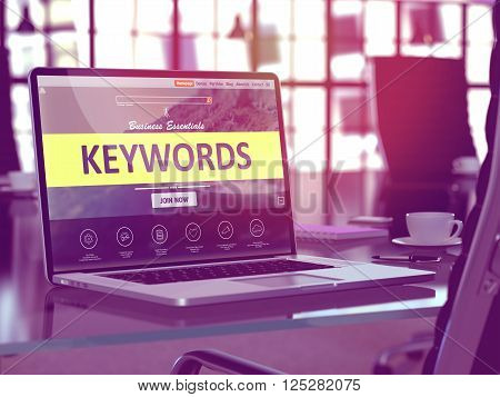 Modern Workplace with Laptop showing Landing Page with Keywords Concept. Toned Image with Selective Focus. 3D Render.
