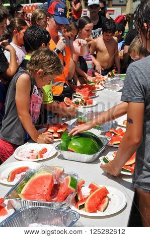 COOGEE,WA,AUSTRALIA-JANUARY 26,2016: Coogee beach festival with kids and spectators at the watermelon eating competition in Coogee, Western Australia.