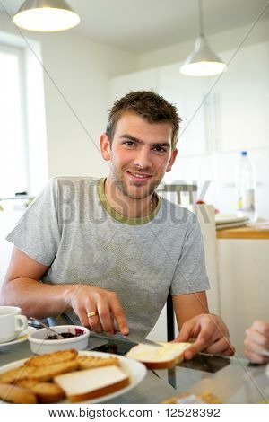 Portrait of a smiling man having breakfast