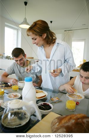 Portrait of a smiling family having breakfast