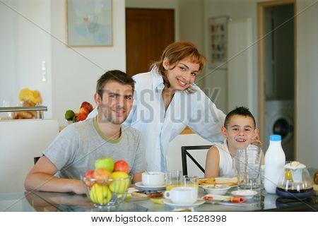 Portrait of a smiling family having breakfast