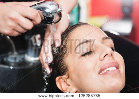 Hair salon - washing hair, horizontal image,