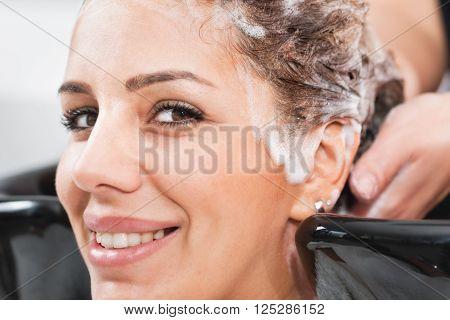 Hair Salon - washing hair, looking at camera