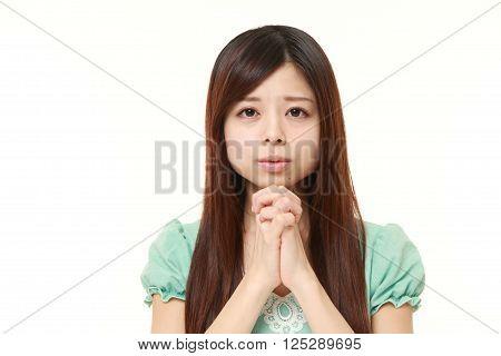 portrait of woman folding her hands in prayer