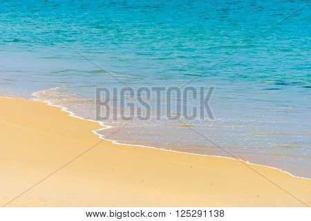 the sand beach with sea and wave texture of blue sky sea wave