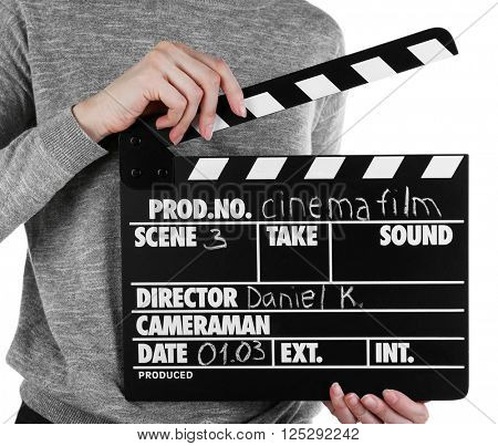 Female hands holding movie clapper isolated on white
