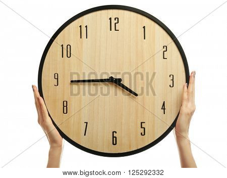 Woman's hands holding a clock, isolated on white