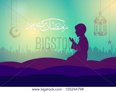 Illustration of a Praying Muslim Boy and Arabic Islamic Calligraphy of text Ramadan Kareem on Mosque silhouetted background.