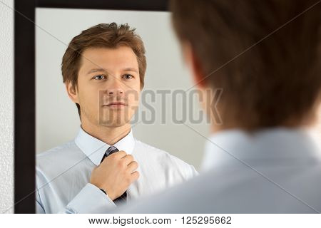 Handsome Businessman Preparing To Official Event, Straighten Tie