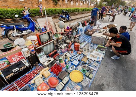 LAMPANG, THAILAND - FEB 19: Old televisions and other junk for sale at a street flea market on February 19, 2016. Population of Lampang is near 59000 people
