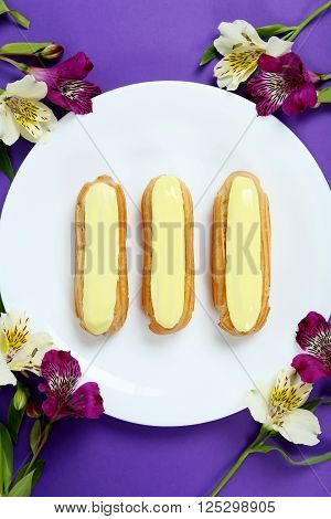 Eclairs With Glaze On A Paper Background