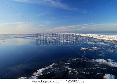 Frozen sea landscape with ice and snow in winter