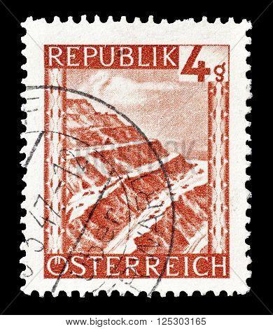 AUSTRIA - CIRCA 1946 :  Cancelled postage stamp printed by Austria, that shows Eisenerz surface mine.