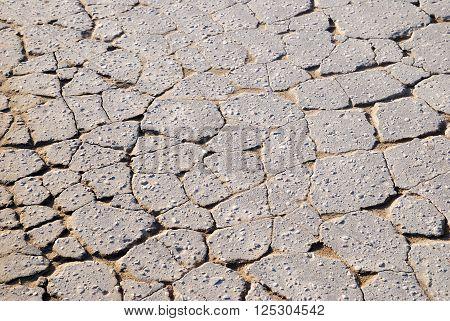 Cracked asphalt road texture. Broken old road.