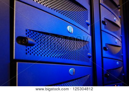 Panel modern mainframe closeup blue blur server room