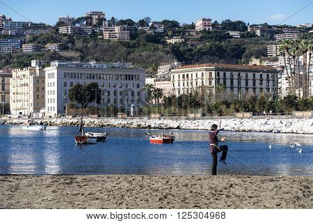 NAPLES - DECEMBER 8: man practice oriental discipline on the beach in the bay of Naples on December 8, 2014 in Naples, Italy