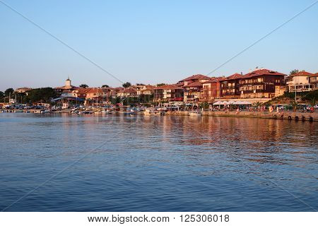 NESSEBAR BULGARIA - JULY 17 2015: View on street Kraybrezhna at sunset in old town of Nessebar Bulgaria. Ancient city of Nessebar is a UNESCO world heritage site.