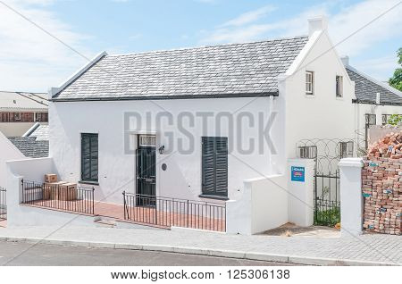 PORT ELIZABETH SOUTH AFRICA - FEBRUARY 27 2016: A typical Settler cottage in Georgian architectural style dating from about 1840. A declared national monument
