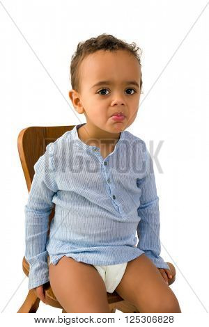Funny African toddler not liking the food in his mouth