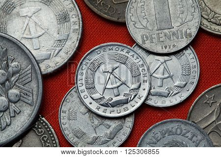 Coins of East Germany. Coat of arms of the German Democratic Republic depicted in the East German one pfennig coin (1968).