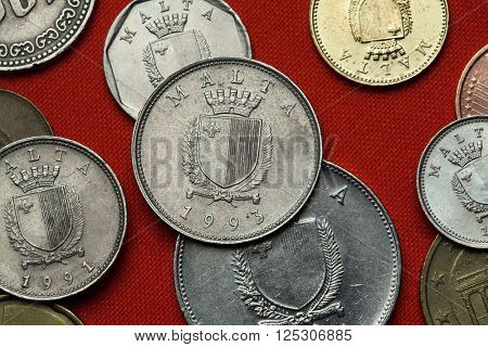 Coins of Malta. Coat of arms of Malta depicted in the Maltese lira coins.