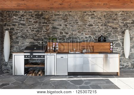 House, modern kitchen with barbecue on the veranda