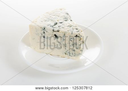 cheese on a white plate on white backgtound
