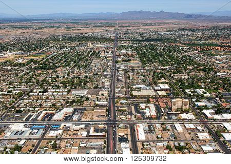 Aerial south to north view of State Route 87 known as Country Club Drive with Main Street in the foreground above Mesa Arizona